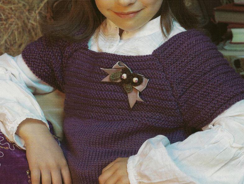 Lavori a maglia crea una blusa elegante per bambina