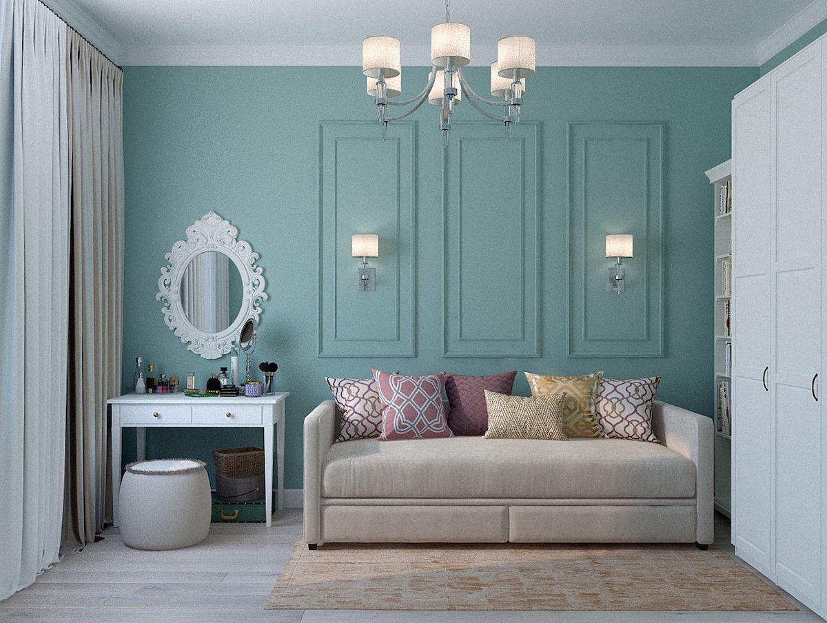 salotto arredamento divano beige parete azzurra