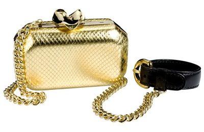Borse Moschino: pochette in pitone dorato
