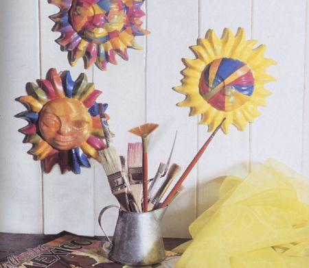 Decoupage: un sole in ceramica multicolore per ridare vita alla tua cucina