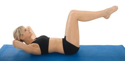 esercizi pilates addominali gambe piegate