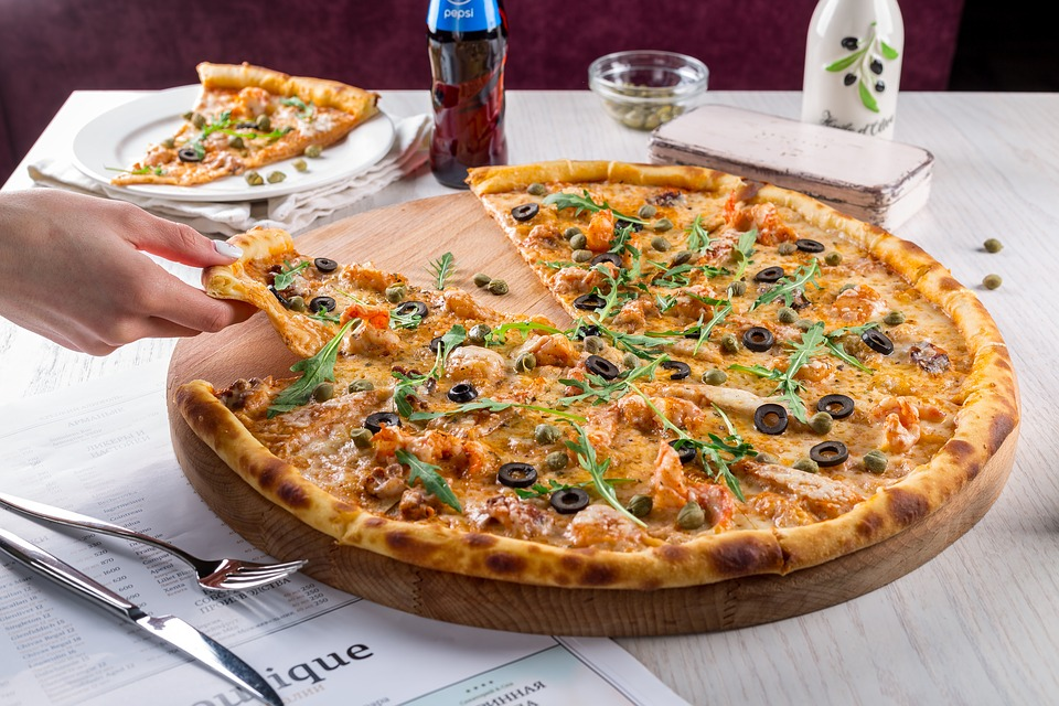 Dimagrire mangiando la pizza? Sì, ma occhio alle calorie!