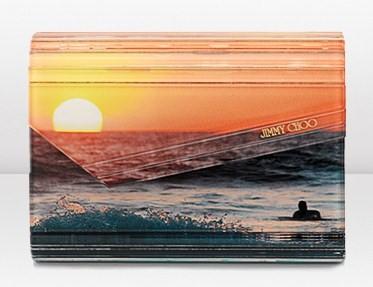 """Clutch Jimmy Choo, la nuova """"Candy"""" con stampa mare al tramonto"""