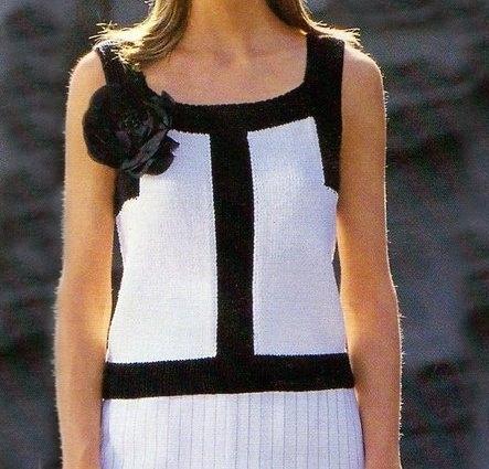 Lavori a maglia: una canottiera elegante bianca e nera
