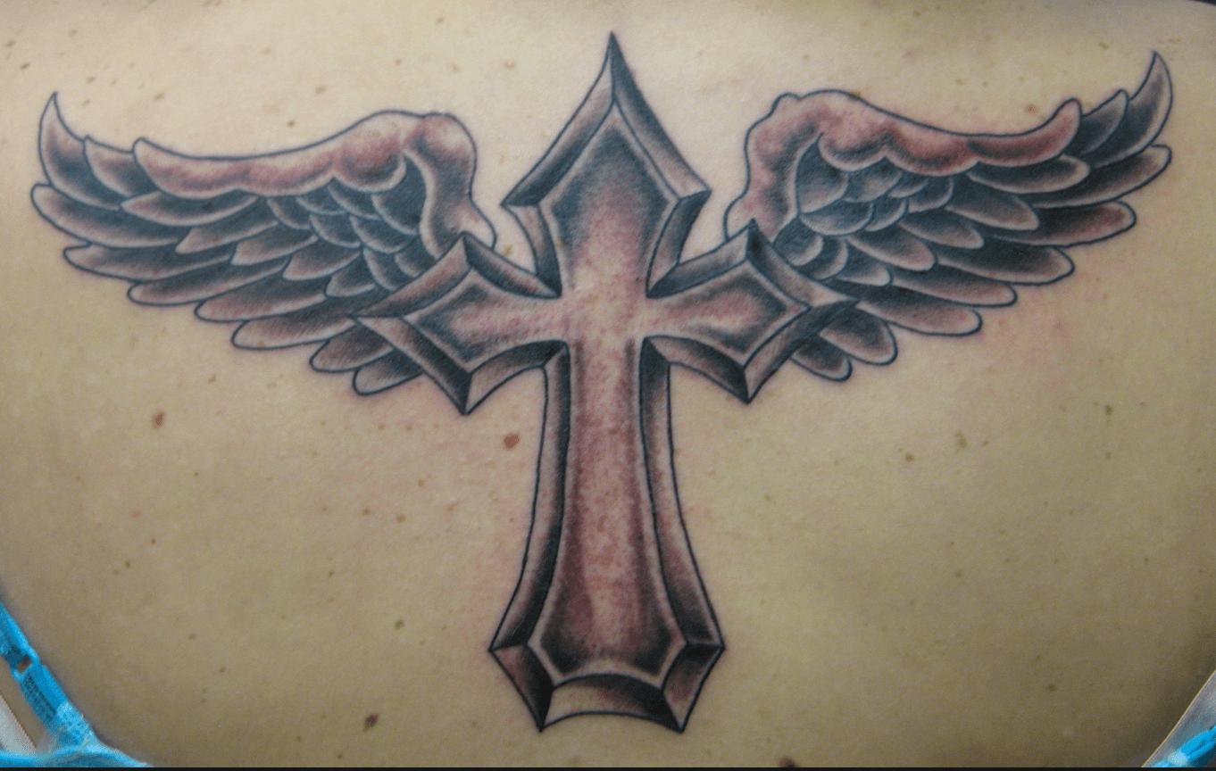 Tattoo croce con le ali sfumata in rosso