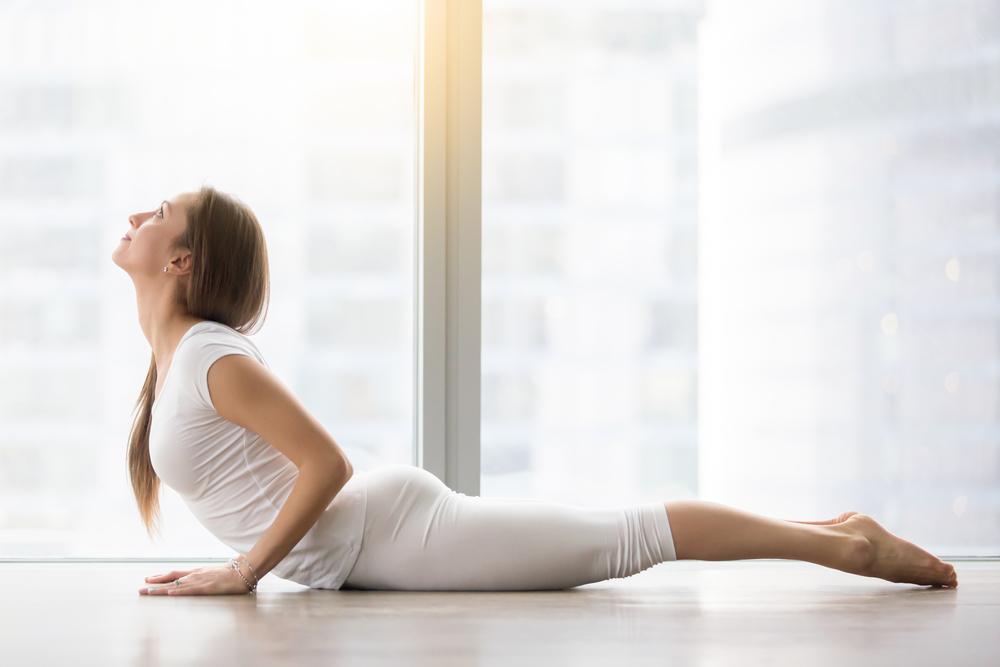 posizione yoga cobra per concepire