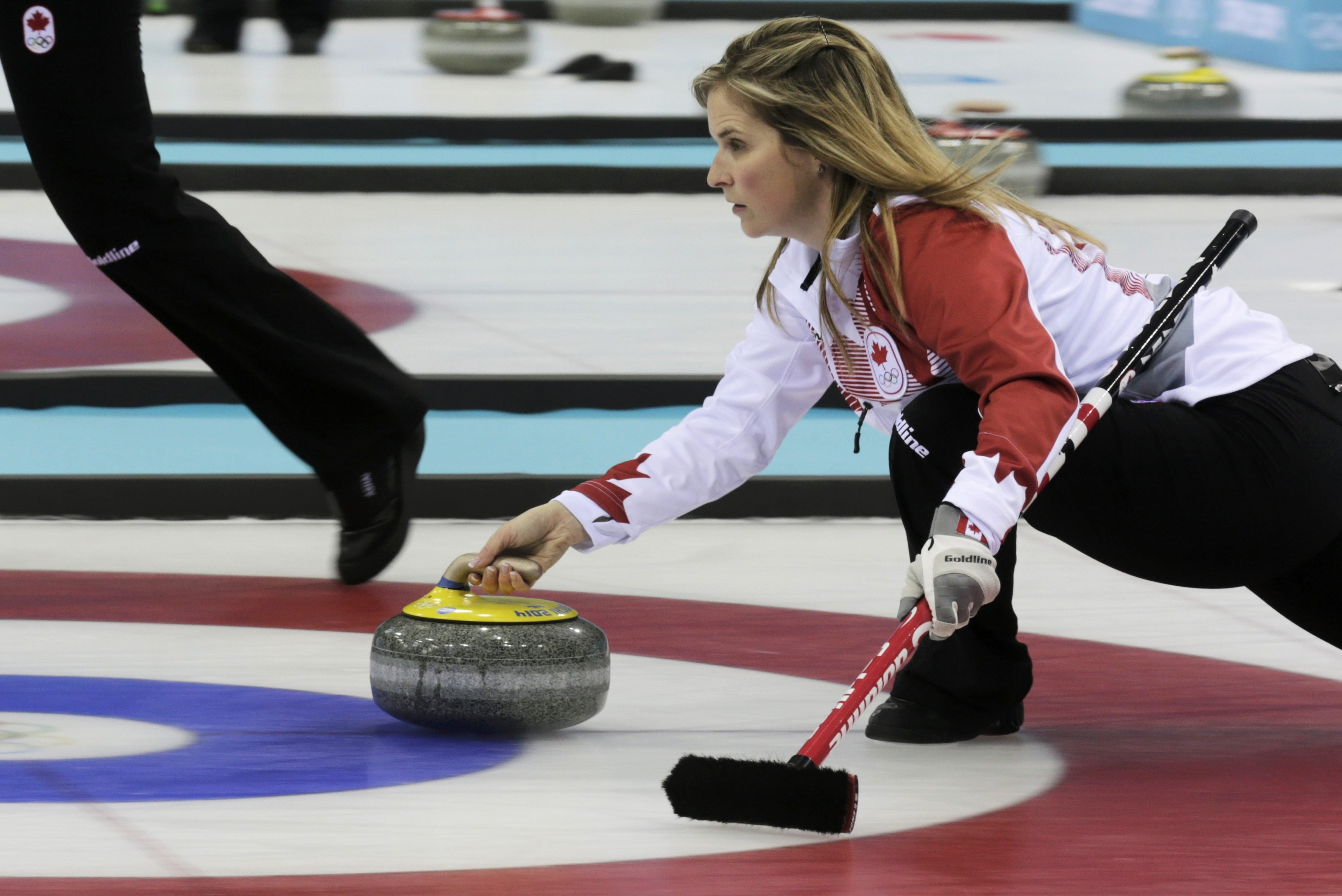 Canada's skip Jennifer Jones delivers the stone in their women's curling round robin game against Sweden at the Sochi 2014 Winter Olympic Games