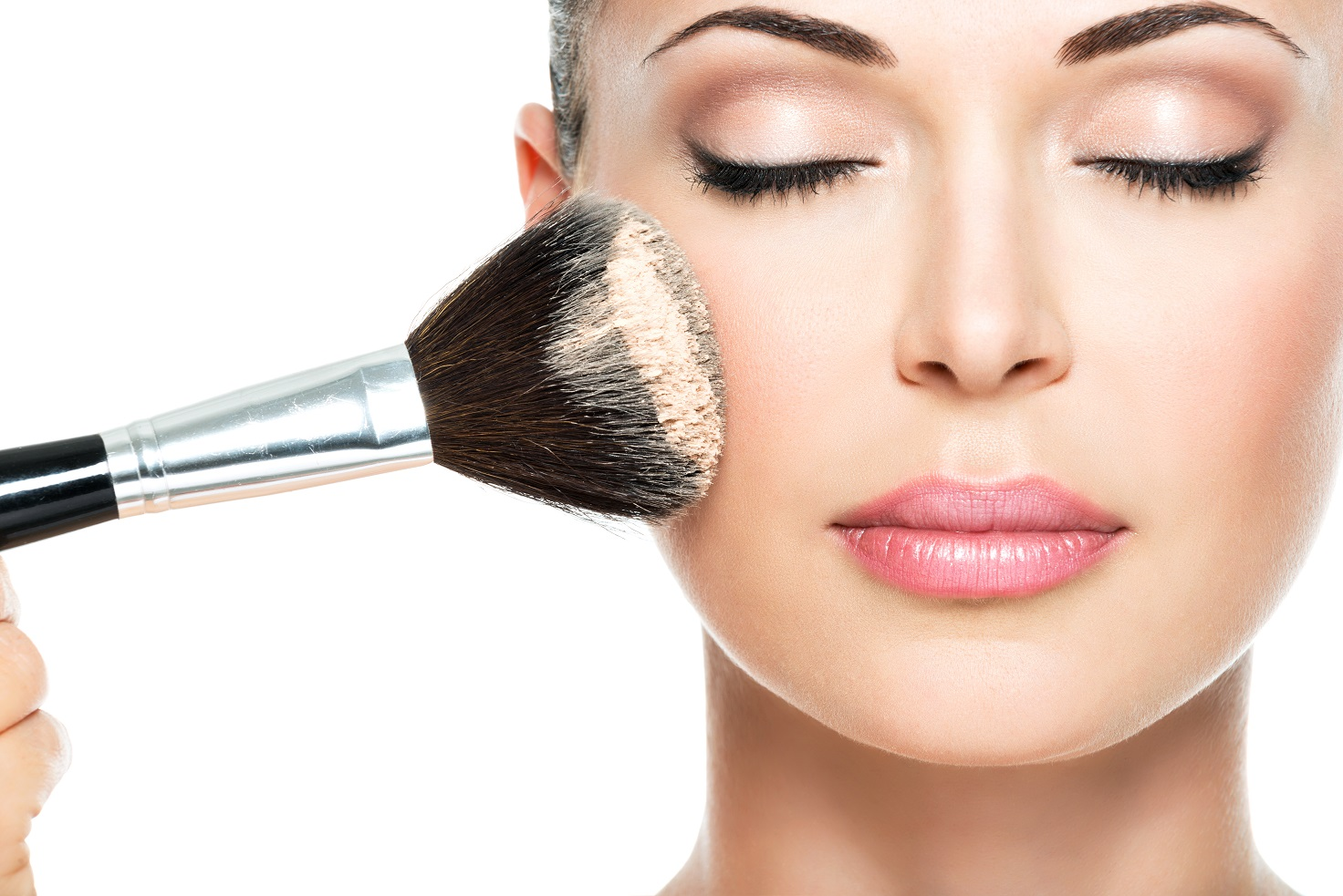 woman applying dry cosmetic tonal foundation on the face