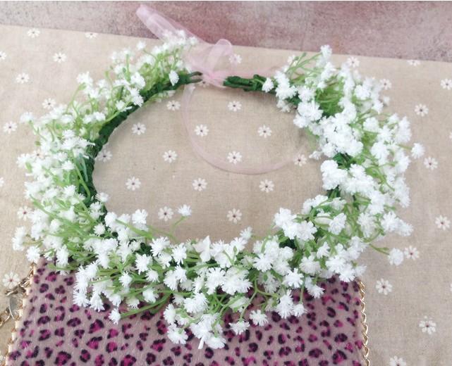 Ghirlanda con fiori bianchi