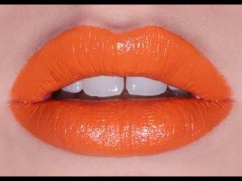 rossetto arancione denti bianchi