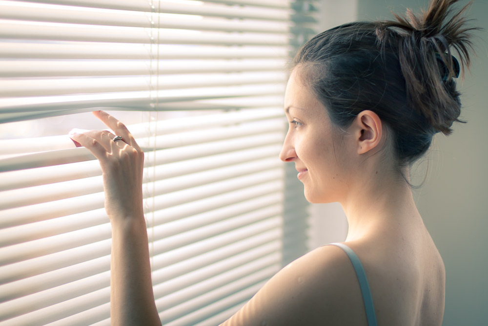 curious_woman_window