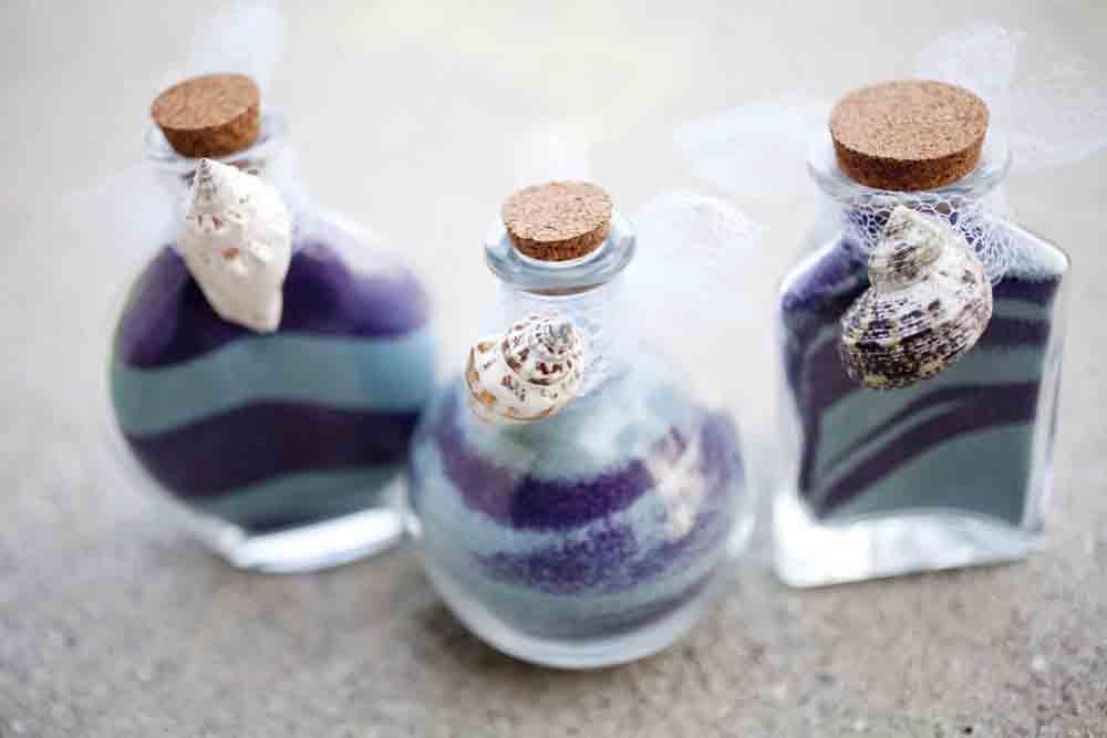 Boccette di vetro riempite di sabbia
