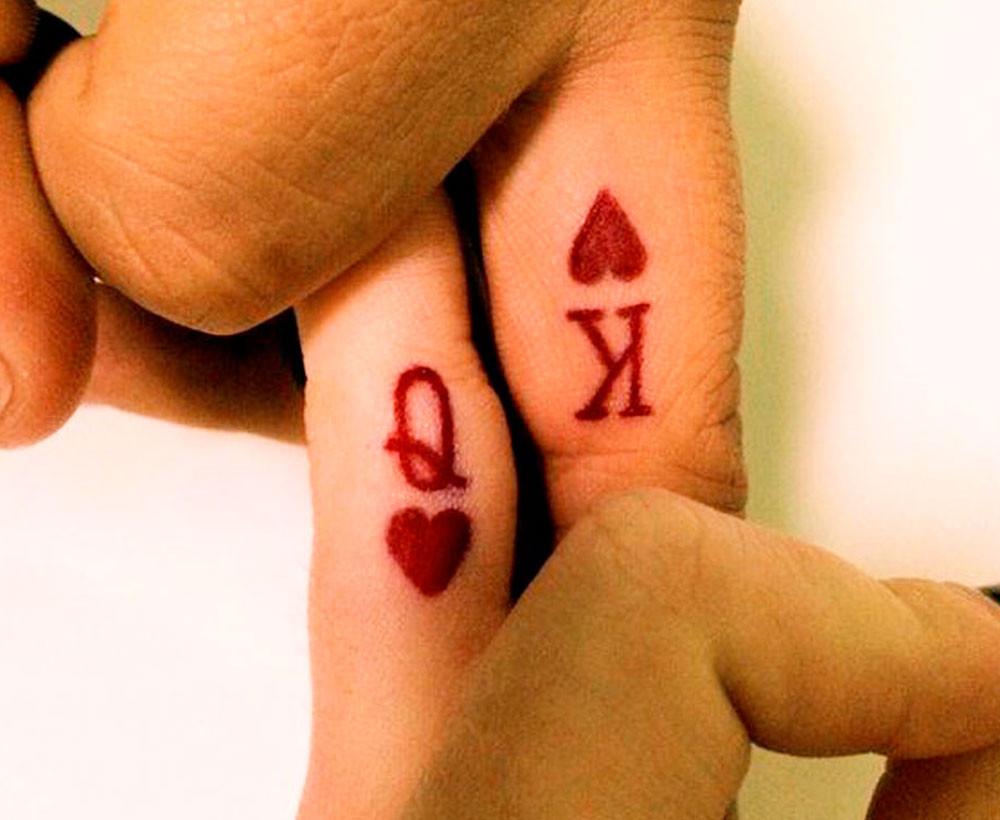 Tatuaggio di coppia con simboli delle carte