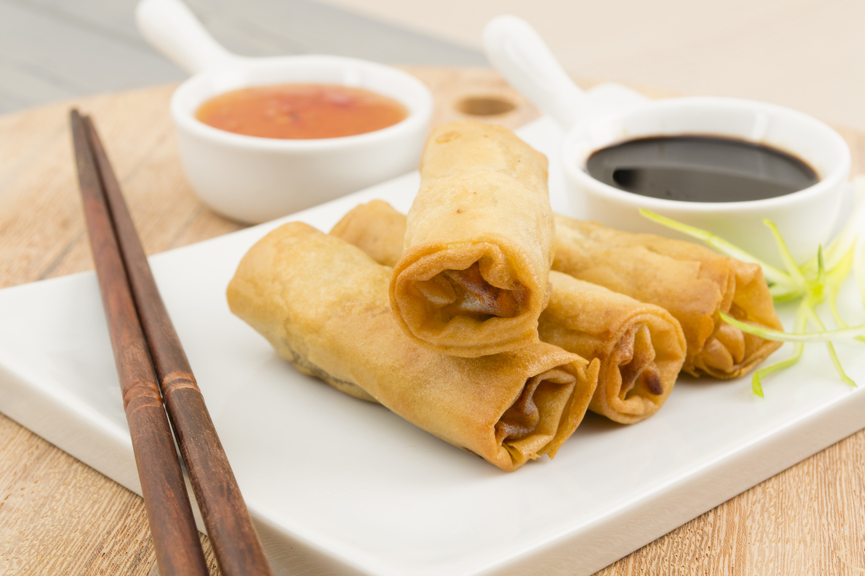 Spring Rolls   Fried duck spring rolls, soy & sweet chili sauce