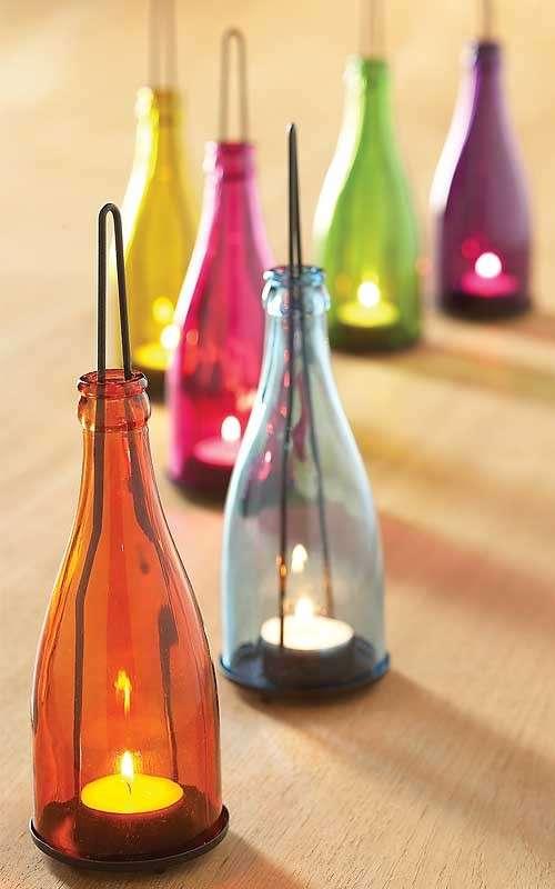 Bottiglie colorate portacandele