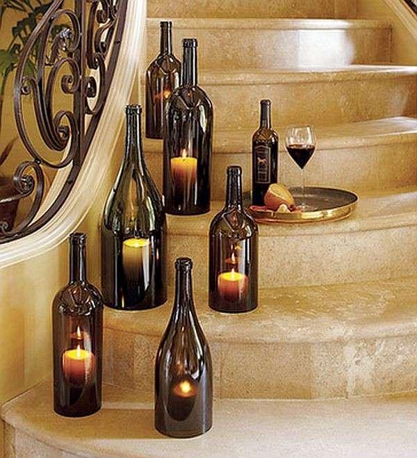 Portacandele con bottiglie di vino