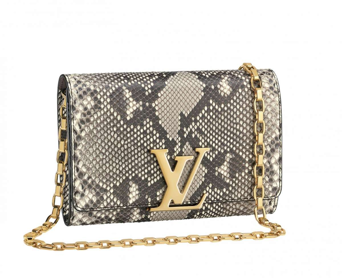 Clutch in rettile Louis Vuitton