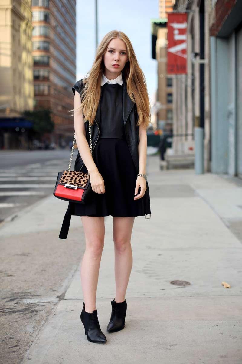 Vestito nero e borsa animalier