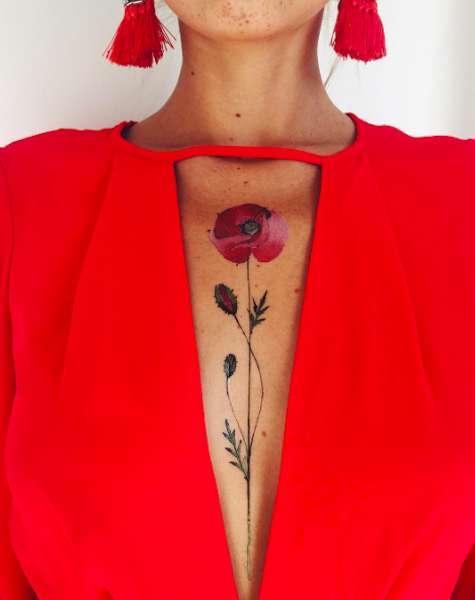 Tatuaggio delicato con fiore