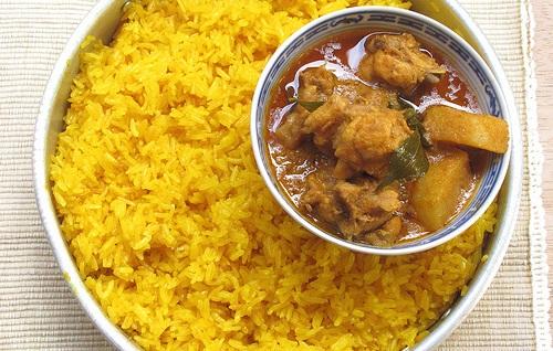 pollo mandorle riso al curry